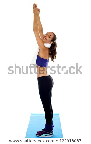 Woman standing erect and stretching hands upwards Stock photo © stockyimages