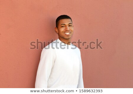 Smiling businessman standing with his arms folded against a white background Stock photo © wavebreak_media