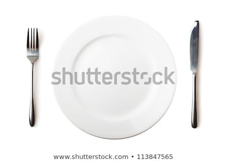 Vacío placa tenedor cuchillo aislado blanco Foto stock © luckyraccoon