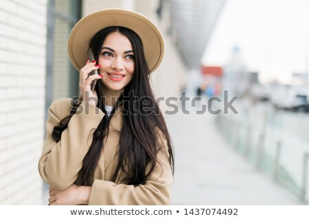 Girl talking with a Smartphone Stock photo © Spectral