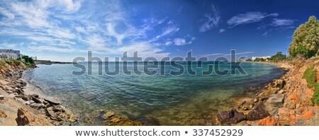 illuminated rocky beach and transparent mediterranean sea in the stock photo © anshar