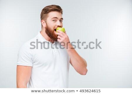ハンサム カジュアル 男 食べる リンゴ 白 ストックフォト © Discovod