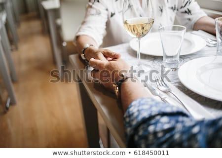 Elegant couple holding wineglass Stock photo © zzve