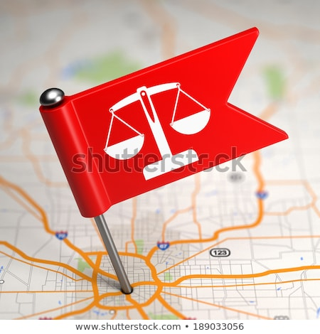 Justice Concept - Small Flag on a Map Background. Stock photo © tashatuvango