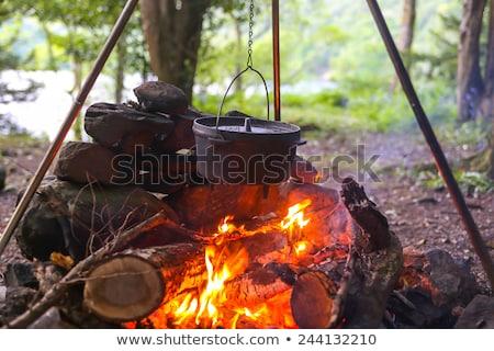 Cowboy gotowania jedzenie starych twarz widoczny Zdjęcia stock © PixelsAway