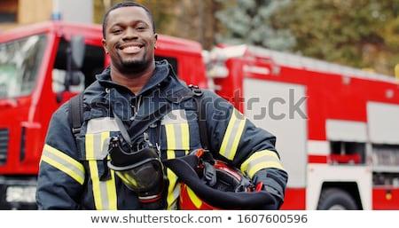 Stockfoto: Brandweerlieden · ladder · vrachtwagen · blauwe · hemel · water · rook
