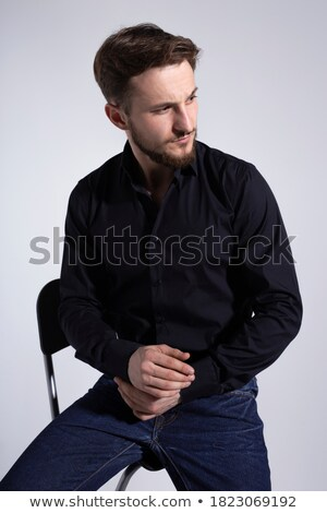 Man seated on a chair, smiling and looking up to the light: - sign of faith , isolated on black, stu Stock photo © alexandrenunes