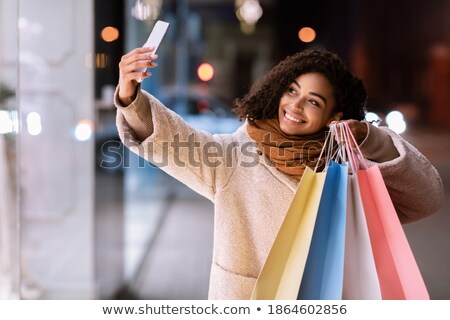 Young woman taking camera from her bag outside Stock photo © wavebreak_media