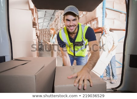 Delivery driver loading his van with boxes  Stock photo © wavebreak_media