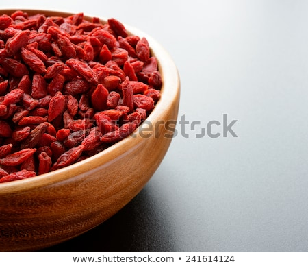 Heap of Dry Goji Berries on the Dark Table Stock photo © maxpro