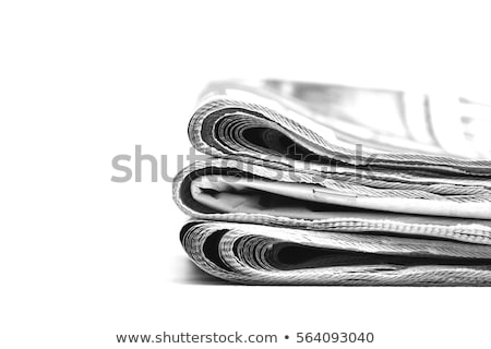 isolated pile of newspapers on a white background stock photo © zerbor