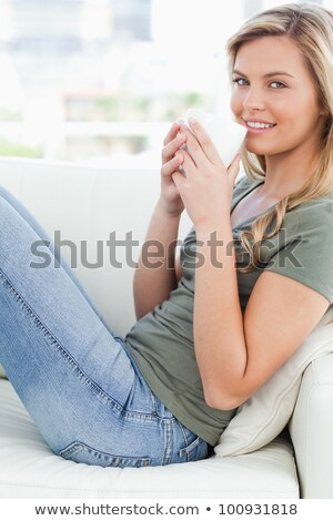 blonde woman holding one leg up stock photo © feedough
