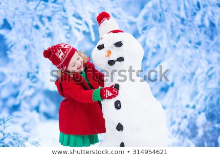 happy girl making a snowman stock photo © mady70