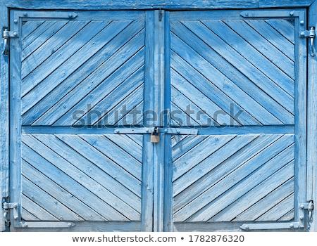 Old blue door of a garage Stock photo © michaklootwijk