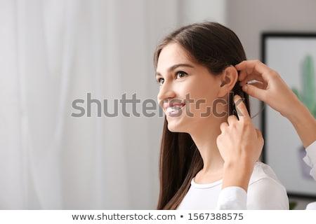 vrouwelijke · hand · gehoorapparaat · oor · vrouw - stockfoto © andreypopov