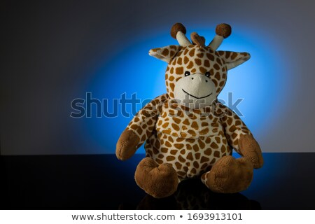 cuddling with the blue teddy giraffe stock photo © pedromonteiro