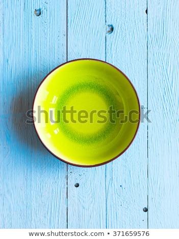 Colorful Orange fruits over a light blue painted wood table Stock photo © DavidArts
