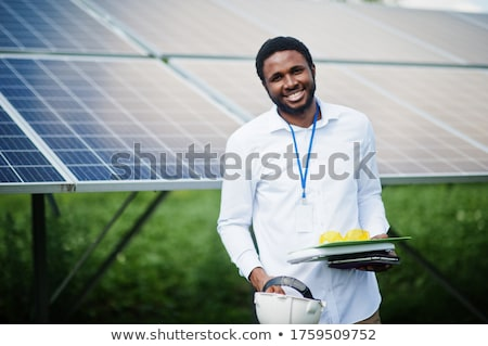 Engineer working with laptop repairing  solar panels Stock photo © zurijeta