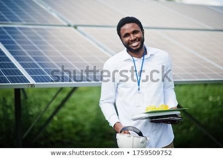 engineer working with laptop repairing solar panels stock photo © zurijeta
