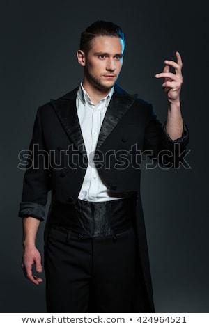 серьезный молодым человеком маг черный хвост пальто Сток-фото © deandrobot