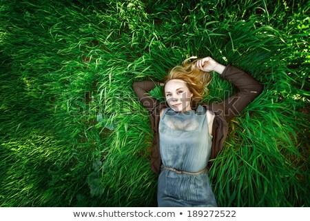 Blond in green grass Stock photo © leedsn