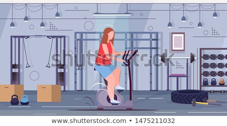 woman riding stationary bicycle stock photo © rastudio