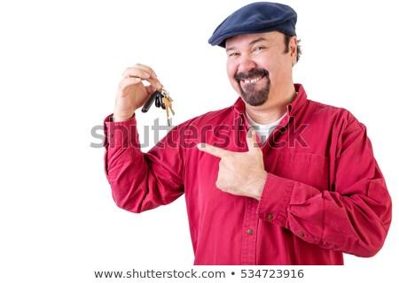 Uśmiechnięty wskazując kluczyki biały Zdjęcia stock © ozgur