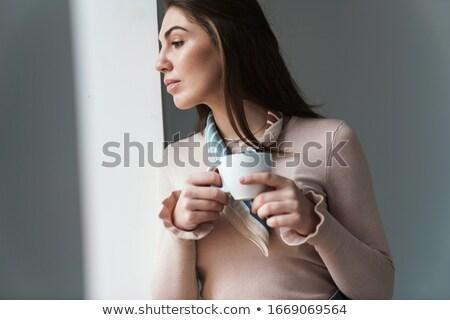 şaşırtıcı kadın içme kahve poz resim Stok fotoğraf © deandrobot