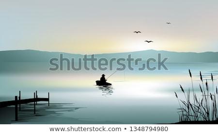 Solitario pescador silueta pescador hermosa puesta de sol Foto stock © joyr