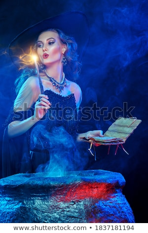 beautiful woman in black hat over night lights Stock photo © dolgachov