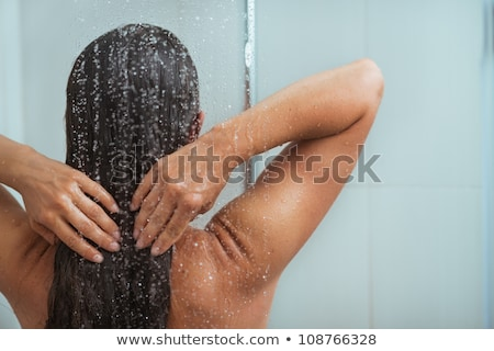 Woman enjoying water in the shower under a jet Stock photo © master1305