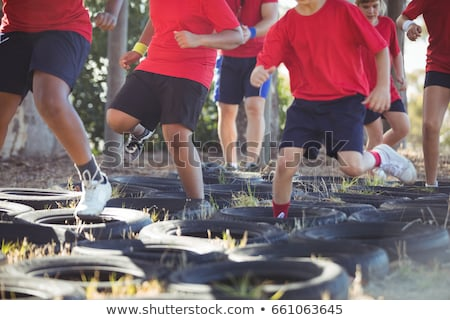 Trainer instructing kids during obstacle course training Stock photo © wavebreak_media