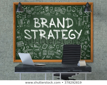 hand drawn brand strategy on office chalkboard stock photo © tashatuvango
