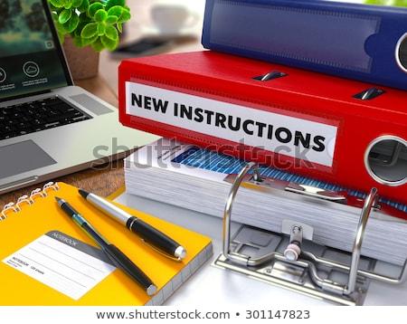 new instructions on blue ring binder blurred toned image stock photo © tashatuvango