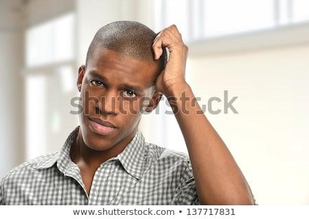 Young african-american businessman scratching head Stock photo © RAStudio