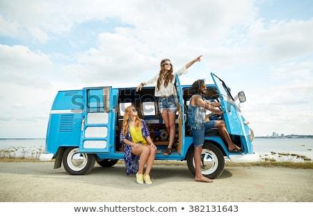 Stock photo: friends traveling on retro minivan