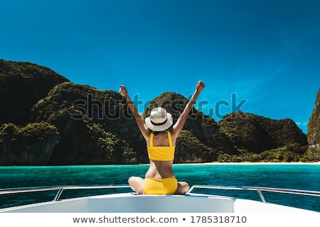 Woman on sailboat arms open Stock photo © IS2