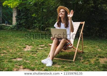 Teen girls look laptop in hammock Stock photo © IS2