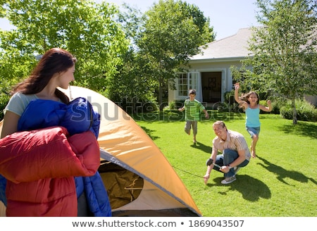 Girl and boy carrying tent bag Stock photo © IS2
