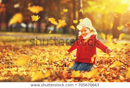 Girls throwing autumn leaves Stock photo © IS2