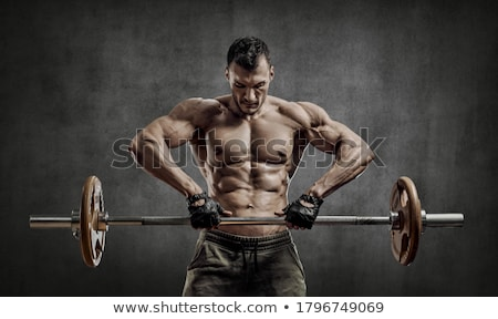 man exercising with weights at gym Stock photo © IS2
