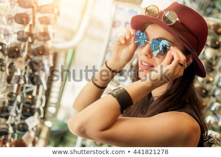 women shopping trying sunglasses stock photo © is2