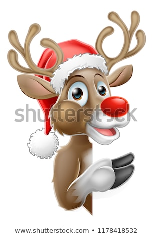 Reindeer in Santa Hat Pointing from Behind Sign Stock photo © Krisdog