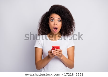 close up portrait of a shocked young girl stock photo © deandrobot