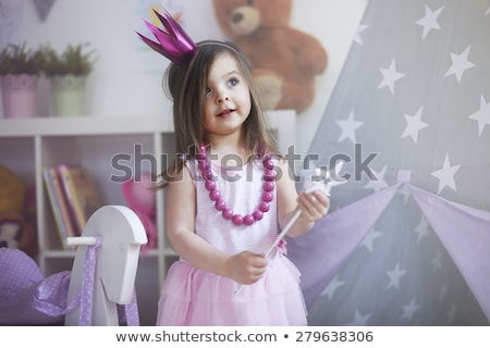 little girl playing with decoration stock photo © is2