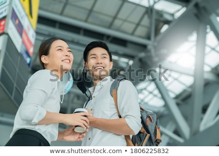 Asian businessman with suitcase waving hand Stock photo © studioworkstock