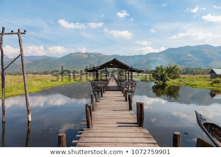brug · mijn · dorp · meer · houten · pijler - stockfoto © romitasromala
