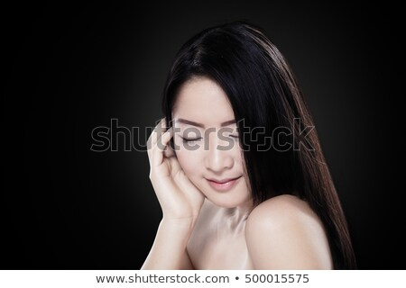 Stockfoto: Image Of Smiling Chinese Woman With Long Dark Hair Looking Aside