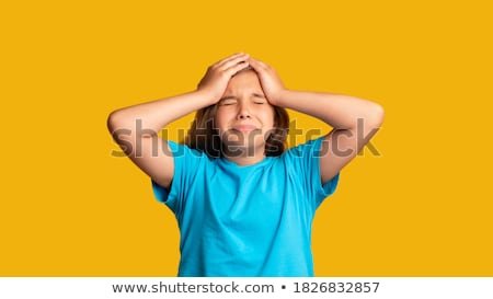 portrait of an upset young casual girl suffering stock photo © deandrobot