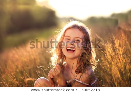 happy beautiful baby girl with flower on head Stock photo © svetography